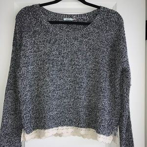 Grey and white short sweater with lace bottom.